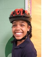 Dr. Menendez distributed bike helmets to the students who attended. The helmets were sponsored by Dr. Menendez and Care Regional Medical Center.