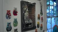 Chic glass wall vases and steel mirror.