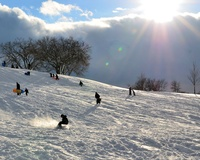 Sledding at The Cascades- Photo by Tom Steele
