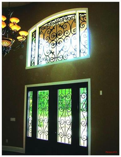 Tableaux Faux Iron Solutions is a perfect decorative solution for custom windows. It's a green product and is lightweight and more inexpensive than wrought iron!