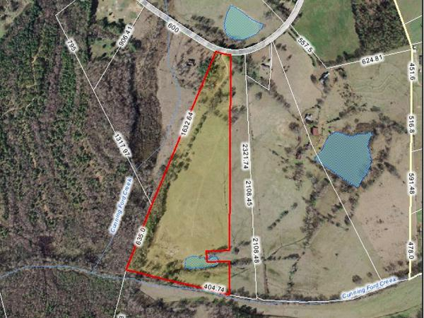 Want acreage? I can help! This beauty touches a pond & is 29 acres