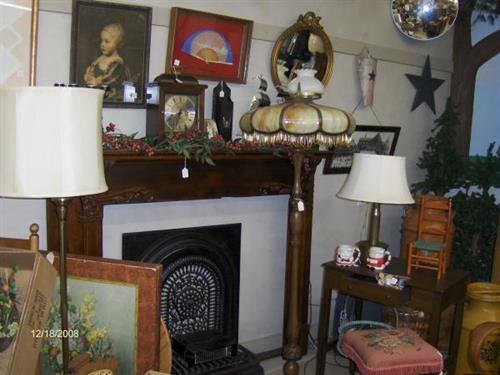 Fireplace mantle, lamps, pictures