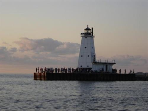 Ludington Lighthouse just across the street. Sunset on the Pier.