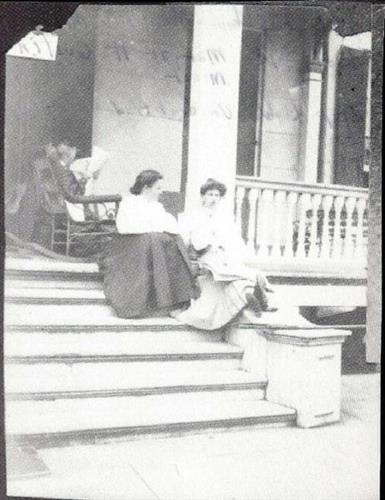 Members of the Minor Family sit on the porch