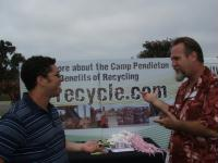 Staff Member Educates Installation Personnel about Recycling for Earth Day 2009