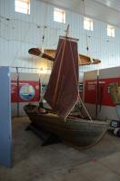 The Norwegian skiff and an Ojibwe canoe by our boatbuilding and winter displays.
