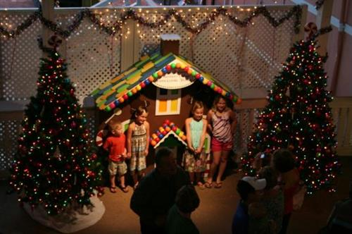 Children gather at the Gingerbread house during Festival of Lights!