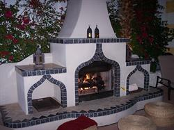 Cuddle up by one of the three fireplaces, two of them poolside and one in the library!