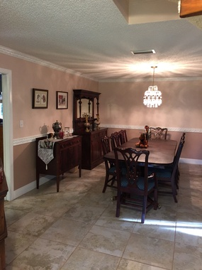 Formal Dining Room with Crown Moulding and Chair Rail