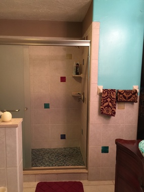 Shower done with Stained Glass Accent tiles and floor