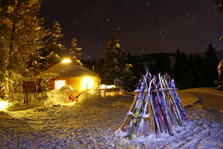 The Magic Meadows Yurt aglow while skiers enjoy dinner inside.