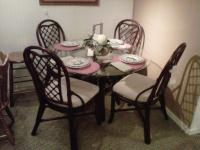 Glass top dinette set priced at only $599.00.