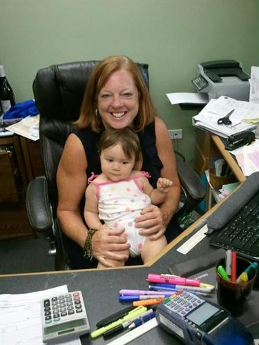 Owner Nancy Solomon w/ youngest employee!