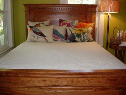 Queen size bed handcrafted in India of Acacia wood