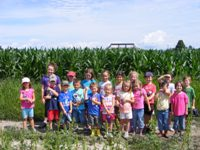 Junior Farmer's camp kids in front of corn maze