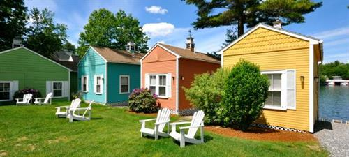 Choose from one of our colorful cottages along the water.