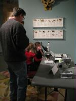 Museum Director Pat Kociolek enjoys time with young vistors.