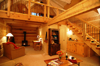 All 18 cabins are equipped with a fireplace, loft-style bedroom and private bathroom.