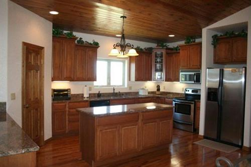 Cactus pine wood ceiling and red oak floors with upgraded appliances