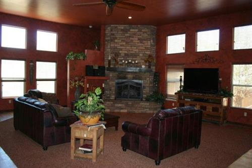 Numerous high set windows with faux painting and custom rock fireplace