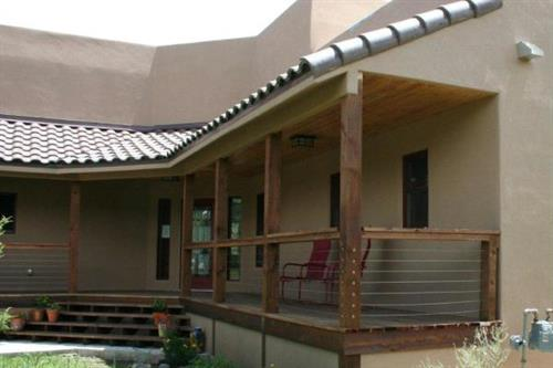Spanish tile roof with custom redwood deck