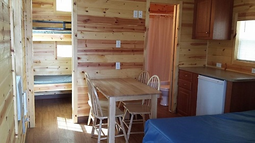 Deluxe Cabin featuring full bath with seperate bedroom