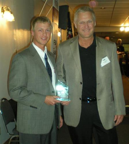 Derek and Kent Burnstad receiving Member of the Year Award