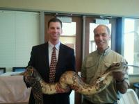 Thane Maynard, Eric Miller and ''Princess'' the snake at the April Monthly Membership Meeting