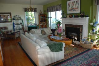 Sit by the fire in our comfy Cape Cod style living room