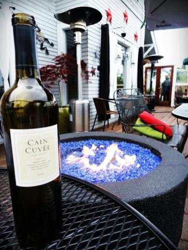 Enjoy a nice bottle of wine at one of our many tables on the deck