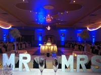 Wedding In White Chair Covers w/ Navy Sash & Blue Uplighting