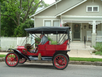 The Brenham House Guests driving a Model -T