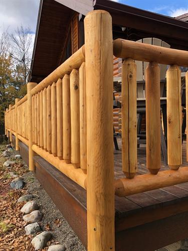 - Chinked the logs - Stained the House - Supplied and installed a new White Cedar Log Railing - Stained the Log Railing - Stained the Deck