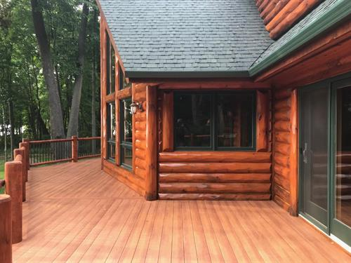 - Stain full log home - Tear off old decking and railing - Install new Zuri Composite Decking - Supply and Install new custom White Cedar Log Railing  - Stain new Log Railing