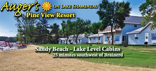 Sandy beach and lake level cabins!