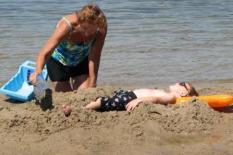 Grandma and Grandson making Shing Wako Resort sandy beach memories