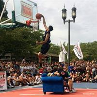 Annual Basketball Tournament, dunking over the blue couch