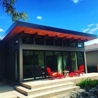 The lucky owner of this cheery sunroom addition by Crescent Builds is sure to enjoy the Washington State sunshine and the security of knowing that the roof and walls were built with SIPs!
