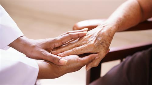 Gallery Image senior-woman-talking-with-black-doctor-in-hospice-PQRFRSD.jpg