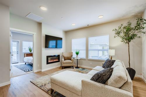 Great room with high ceilings, natural light and fireplace for heat and entertainment.