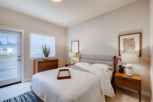 Spacious master bedroom with low pile carpet & natural light.