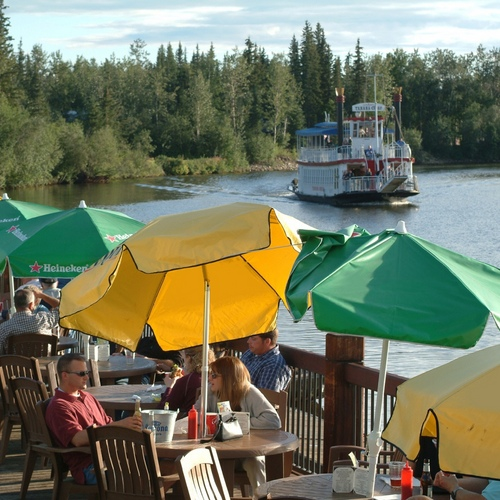 Dining on a deck along the Chena River