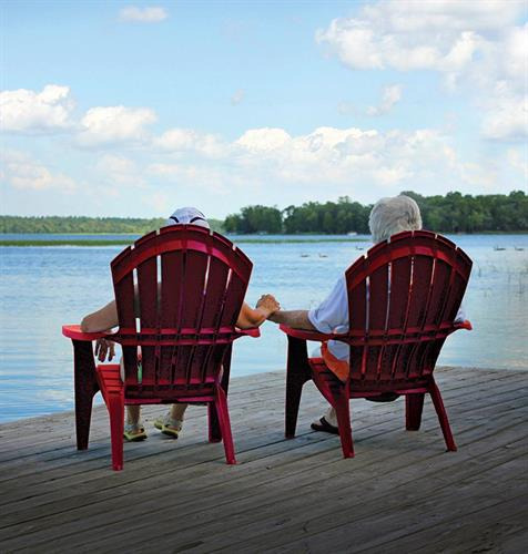 Couple relaxing and holding hands on Leech Lake