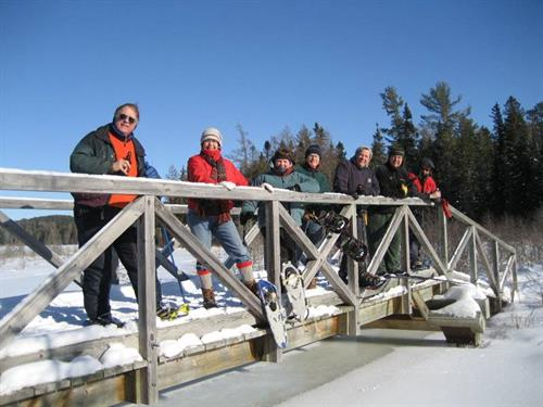 Snow shoeing the North Country Trail crossing the Shingobee Bridge