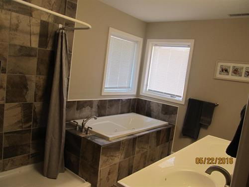 Upstairs bathroom with jetted tub