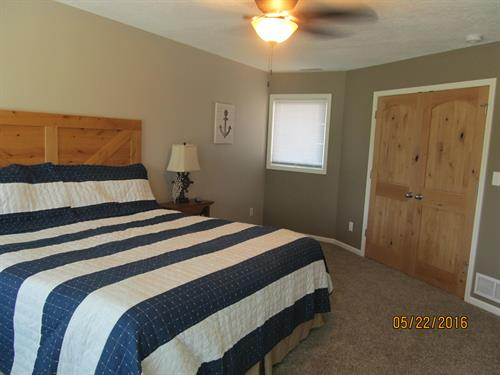 Upstairs bedroom with lake and golf course views