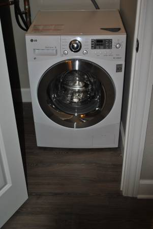 Combination washer/dryer (washes and dries clothes in one unit!)