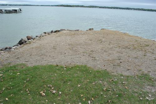 State owned shoreline in front of complex has sand area that can be used as a beach.
