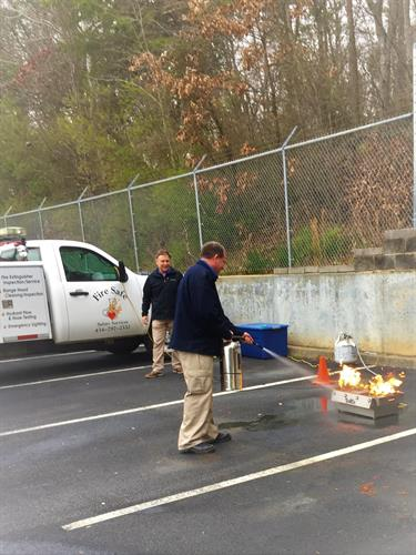 "Fire Extinguisher ""hands on"" training."