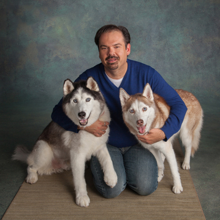 Happy Husky Bakery's co-owner Todd with the Happy Huskies. (Photo by Sutton Studios)